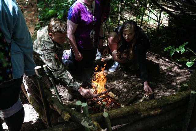 A Soldier assigned to 1st Special Forces Group (Airborne) taught a child from Saint Jude's Children's Hospital how to start a fire on June 30th at Vashon Island, Washington. During the course of a week, the Green Berets showed the children how to survive in the wilderness by teaching them how to build shelters, start fires, and administer first aid.