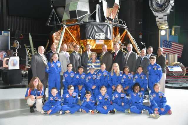 Members of the Air, Space, and Missile Defense Association pose with the 16 recipients of the 2017 ASMDA Space Camp scholarship at the U.S. Space and Rocket Center in Huntsville, Alabama, July 5. Since 1996, ASMDA has sent more than 200 students to Space Camp.