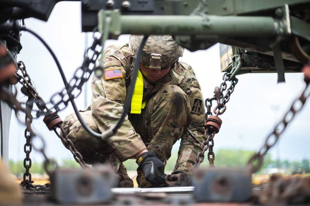 An Indiana National Guardsman fastens and inspects equipment being loaded onto the railcar at Camp Atterbury, In. on July 6, 2017. A group of Guardsmen from Indiana, Illinois and Pennsylvania joined together in support of Task Force Hoosier to assist the 76th Infantry Brigade Combat Team in transporting their equipment to Fort Polk, La. for an upcoming Joint Readiness Training Center Rotation.