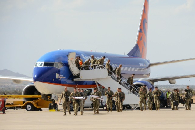 "Soldiers with 2nd Brigade Combat Team, 101st Airborne Division from Fort Campbell, Kentucky, disembark the plane during their arrival for the Network Integration Exercise 17.2, here, July 5. The ""Strike"" Brigade with 101st ABN DIV is the first rotational brigade to conduct NIE here."