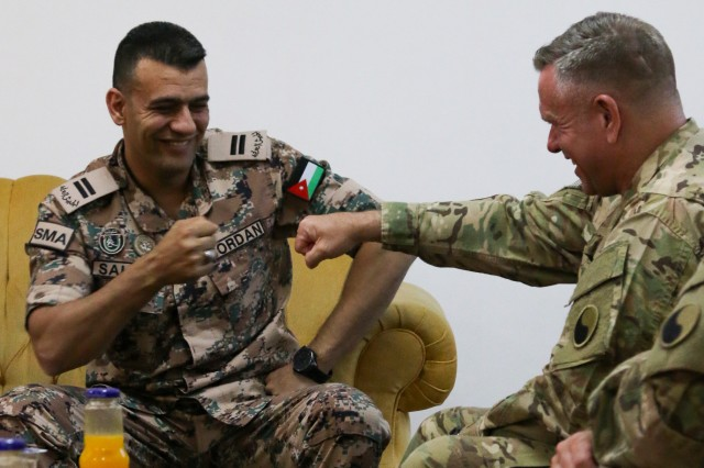 Sgt. Maj. Salem Bani Mustafa, Sergeant Major of the Jordan Armed Forces, shares a fist-bump with Command Sgt. Maj. James Nugent, a Maryland National Guard Soldier assigned to the 29th Infantry Division, during a senior leader engagement at the Jordan Armed Forces-Arab Army NCO Academy May 13, 2017, near Amman, Jordan. While in Jordan from September 2016- July 2017, the NCOs of Task Force 29 participated in more than a dozen exchanges focused on NCO duties and responsibilities in battalion and brigade command post operations.