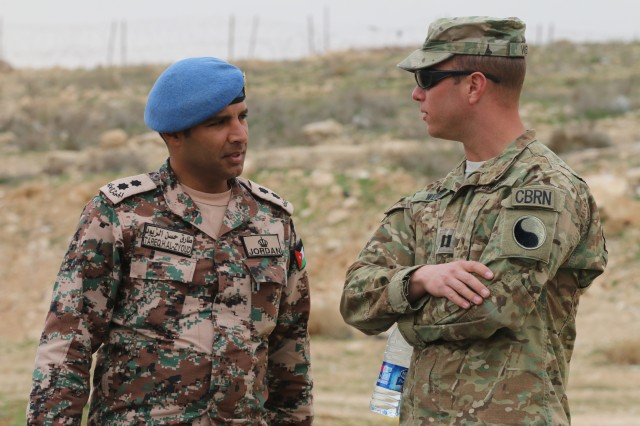 Capt. Brian Webb, a Chemical, Biological, Radiological, Nuclear officer assigned to the 29th Infantry Division, discusses CBRN best practices with a counterpart from the Jordan Armed Forces- Arab Army Feb. 28, 2017, near Amman, Jordan. While in Jordan from September 2016- July 2017, CBRN personnel from the Task Force 29 conducted numerous exercises with joint CBRN and explosive ordnance disposal personnel, as well as Jordanian first responders.