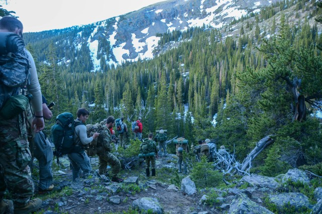 Special Operations Advanced Mountaineering School students lead a force of 10th Special Forces Group (Airborne) Soldiers across a peak in Colorado's Ten Mile Range, June 20, 2017. The Senior Mountaineering Course students led the Soldiers up the 13,000-foot peak for a reconnaissance mission at the top as part of the course's culminating exercise.