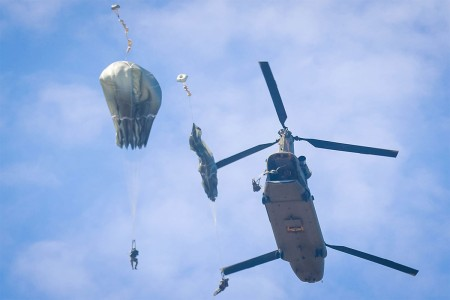 Parachutes open from Soldiers after exiting a CH-47 Chinook helicopter assigned to 3rd General Support Aviation Battalion, 82nd Combat Aviation Brigade, during airborne operations on Sicily Drop Zone at Fort Bragg, N.C., July 6, 2017.