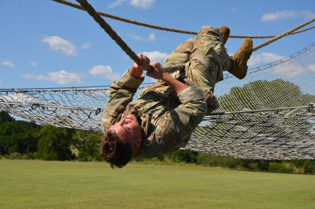 Staff Sgt. Jared Casey maneuvers an obstacle as part of the 2017 Army Contracting Command Best Warrior Competition June 6 at Joint Base San Antonio-Camp Bullis, Texas. Casey bested six Soldiers from throughout ACC vying for the best warrior title over five days of competition and will represent the command at the Army Materiel Command level beginning July 16 at Camp Atterbury, Indiana. He is a contract specialist with the 409th Contracting Support Brigade at Sembach, Germany.