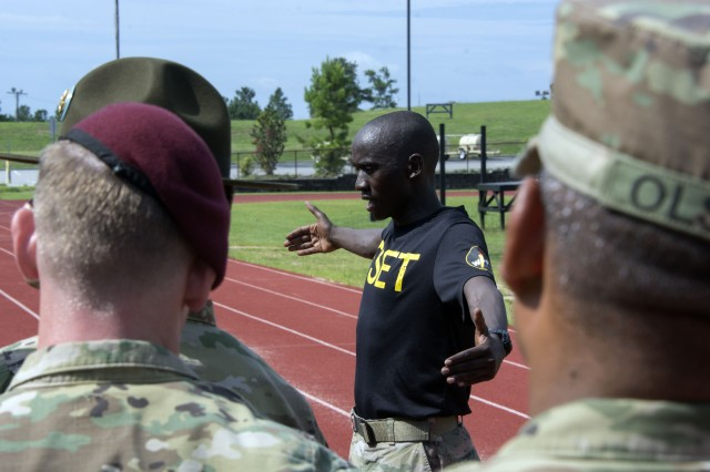 Spc. Emmanuel Bor, a runner with the Army's World Class Athlete Program, showed drill sergeants and enlisted personnel how to improve running skills during Total Soldier Enhancement Training at the U.S. Army Drill Sergeant Academy Tuesday. This educational format is tailored to the units needs to provide a further knowledge base for drill sergeants in order to more effectively address trainees. The group of 15 athletes and coaches will be on post until today