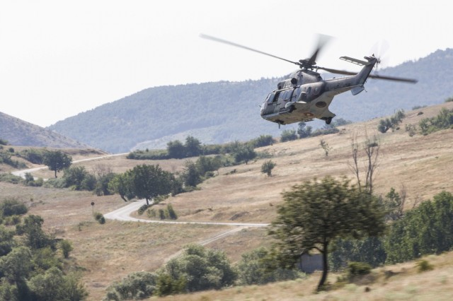An AS532 Cougar helicopter from the Bulgarian Air Force leads a formation during a combat search and rescue mission with A Company, 2-10 Assault Helicopter Battalion, in Plovdiv, Bulgaria, on July 11. The Aviators worked together in planning and executing the training to build interoperability during Saber Guardian 17.