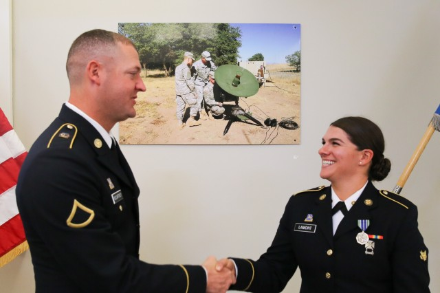 Pvt. 1st Class Chip McCartney (left) and Spc. Yvonne Lamont (right) congratulate each other on their selection as Honor raduates for 35G Geospatial Imagery Analyst Course (Class 17-008).
