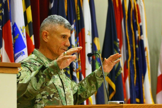 Lt. Gen. Robert Caslen Jr., United States Military Academy superintendent, gestures for Basic Combat Training graduates to relax before he begins his speech July 7, 2017, at Fort Sill's Cache Creek Chapel.
