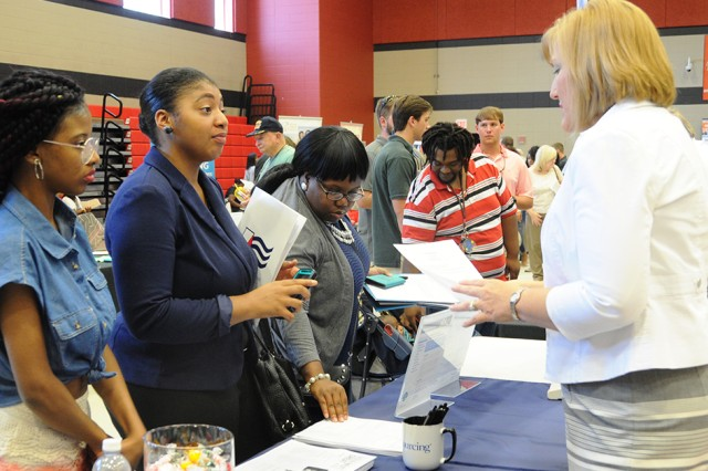 Job seekers speak with employers during last year's Fort Rucker Area Job Fair at the Carroll High School Gymnasium in Ozark. This year's job fair will be held at Enterprise High School.