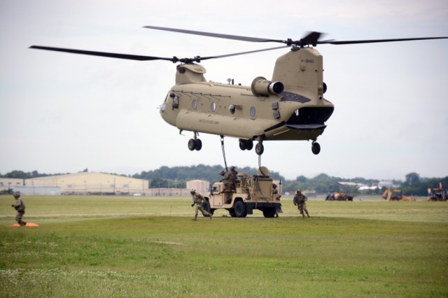 U.S Army Soldiers from the 2nd Brigade Combat Team, 101st Airborne Division (Air Assault), move from under a CH-47 Chinook after successfully hanging up the Tactical Control Node-Light, at Fort Campbell, KY, Jun. 15, 2017. The training was part of the brigade preparation for the Network Integration Exercise at Fort Bliss, where they were the first light BCT to participate, July 5 - 6, 2017. The Tactical Communications Node was originally developed on five-ton Family of Medium Tactical Vehicles (FMTVs). The new Lite (L) versions are integrated onto Humvees, which can be sling-loaded from a helicopter for significantly increased agility and operational flexibility.