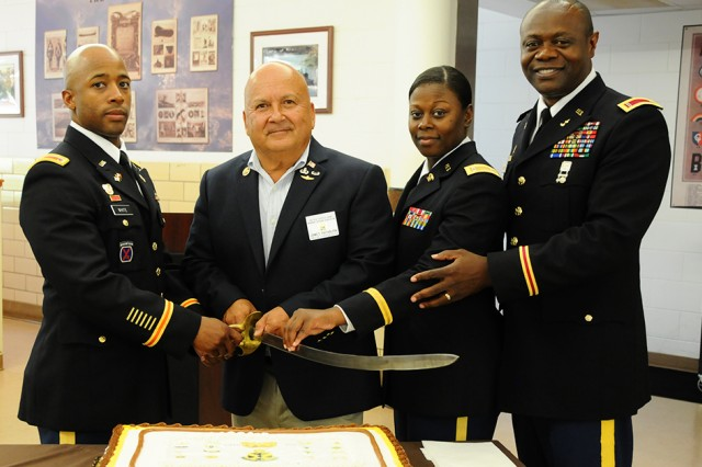 CW4 Jerry White, 1st Warrant Officer Company commander, retired CW5 James Rathburn, CW2 Charita Mixon, 1st WOC, and CW5 John D. Howze, WOCC deputy commandant, prepare to cut the Warrant Officer Cohort birthday cake during a celebration of the 99th birthday of the cohort at the dining facility July 6.