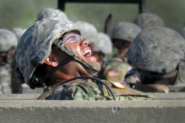 Pvt. Tyler LeBlanc reacts after lobbing a practice grenade at a target Jun 27, 2017, at the hand grenade range here.