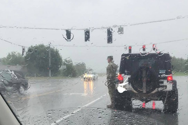 Tennessee National Guard Col. Jack Usrey pulled his vehicle over and saluted a passing funeral procession in this photo that went viral on the internet. He was subsequently identified and spoke by phone to the woman who snapped his photo on July 6, 2017.