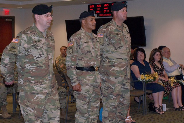 From left to right, Col. Geoffrey Adams, incoming commander, 4th Battlefield Coordination Detachment, U.S. Army Central; Lt. Gen. Michael Garrett, commanding general, USARCENT; Col. Samuel Saine, outgoing commander, 4th BCD; return to their starting position after the passing of the flags portion of the 4th BCD's change of command ceremony at Shaw AFB, S.C., July 11, 2017. Saine relinquished his command of the detachment to Adams.