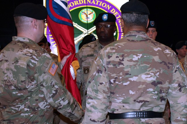 The 4th Battlefield Coordination Detachment, U.S. Army Central incoming Commander Col. Geoffrey Adams, left, passes the 4th BCD's colors to Sgt. Maj. Robert Clark, 4th BCD senior advisor to the commander, during the 4th BCD's change of command ceremony at Patton Hall on Shaw Air Force Base, S.C., July 11, 2017. Col. Samuel Saine, outgoing commander of the 4th BCD, relinquished his command of the detachment to Adams.