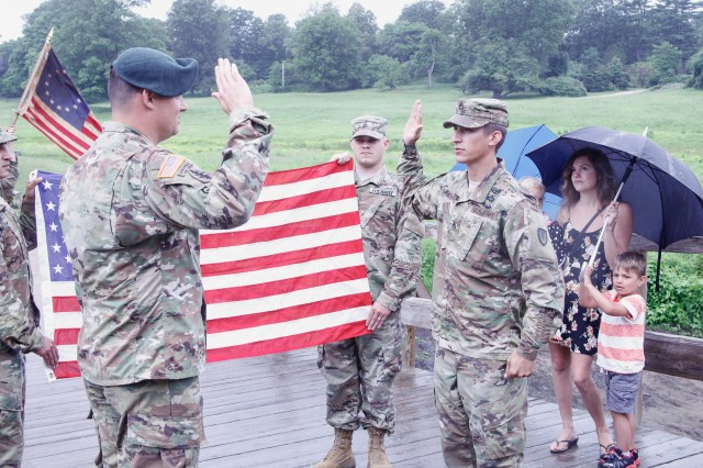 Staff Sgt. Anthony Sandoval, a noncommissioned officer for the Headquarters Research and Development Detachment (HRDD) at the Natick Soldier Research Development and Engineering Center (NSRDEC), takes the oath of reenlistment July 7, on the North Bridge in Minute Man National Historical Park, where the American Revolutionary War Battles of Lexington and Concord were fought.
