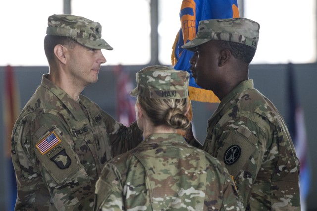 Lt. Col. Matthew L. Rowland passes the guidon to 1st Sgt. Clarence P. Davis during U.S. Army Priority Air Transport Command's (USAPAT) change of command/responsibility ceremony July 14, 2017, at Joint Base Andrews, Md.