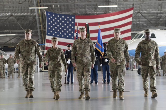 1st Sgt. Christopher L. Brown, Lt. Col. Heather L. Maki, Col. Prescott R. Farris, Lt. Col. Matthew L. Rowland and 1st Sgt. Christopher L. Brown march into position following the passing of the guidon July 14, 2017, at Joint Base Andrews, Md.