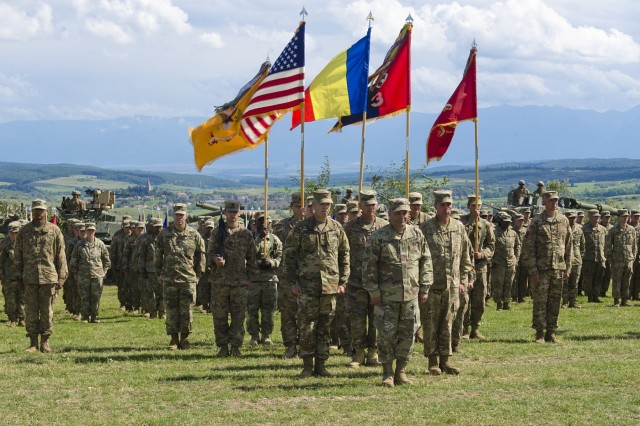 Maj Gen. Ryan Gonsalves, commander of 4th Infantry Division; Col. Christopher Norrie, outgoing commander of 3rd Armored Brigade Combat Team, 4th Inf. Div.; and  Col. Michael Simmering, incoming commander of 3rd Armored Brigade Combat Team, 4th Inf. Div, closed out Getica Saber 17 with a change of command ceremony at the Joint National Training Center in Cincu, Romania, July 15, 2017. Getica Saber 17 is a U.S.-led Fire Support Coordination Exercise and a Combined Arms Live-Fire Exercise that incorporated six Allied and partner nations with more than 4,000 Soldiers. Getica Saber runs concurrent with Saber Guardian, a U.S. European Command, U.S. Army Europe-led, multinational exercise that spans across Bulgaria, Hungary and Romania with over 25,000 service members from 22 Allied and partner nations.  (U.S. Army photo by Sgt. Justin Geiger)