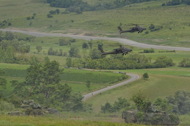 Two AH-64 Apaches and two Bradley Fighting Vehicles participated in the Combined Arms Live-Fire Exercise at the Joint National Training Center in Cincu, Romania, July 15, 2017, during the final phase of Getica Saber 17. Getica Saber 17 is a U.S.-led Fire Support Coordination Exercise and a Combined Arms Live-Fire Exercise that incorporated six Allied and partner nations with more than 4,000 Soldiers. Getica Saber runs concurrent with Saber Guardian, a U.S. European Command, U.S. Army Europe-led, multinational exercise that spans across Bulgaria, Hungary and Romania with over 25,000 service members from 22 Allied and partner nations.  (U.S. Army photo by Sgt. Justin Geiger)