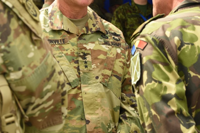 CINCU, Romania - U.S. Army Gen. James McConville, Vice Chief of Staff of the Army, speaks with Romanian Allies, during Distinguished Visitors day for Getica Saber, July 15, 2017. Getica Saber 17 is a U.S.-led fire support coordination exercise and combined arms live fire exercise that incorporates six Allied and partner nations with more than 4,000 Soldiers. Getica Saber 17 runs concurrent with Saber Guardian 17, a U.S. European Command, U.S. Army Europe-led, multinational exercise that spans across Bulgaria, Hungary and Romania with more than 25,000 service members from 22 Allied and partner nations.