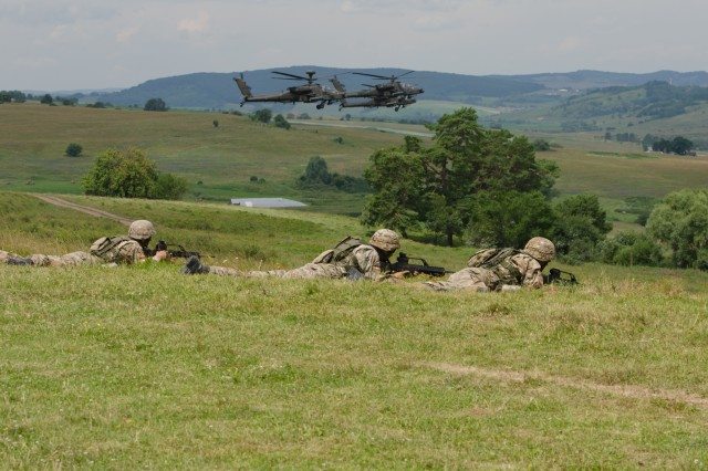 Montenegrin soldiers prepare to move forward to their fighting positions while AH-64 Apaches provide cover during the combined arms live fire exercise portion of Getica Saber, July 15, 2017 in Cincu, Romania. Getica Saber 17 is a U.S.-led fire support coordination exercise and combined arms live fire exercise that incorporates six Allied and partner nations with more than 4,000 Soldiers. Getica Saber 17 runs concurrent with Saber Guardian 17, a U.S. European Command, U.S. Army Europe-led multinational exercise that spans across Bulgaria, Hungary and Romania with more than 25,000 service members from 22 Allied and partner nations.