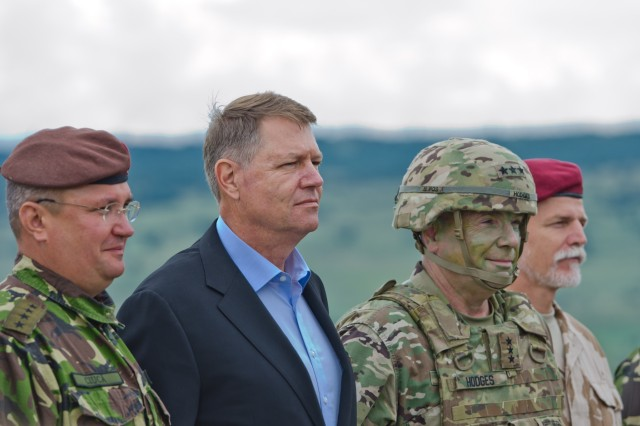 Romania President Klaus Iohannis stands next to U.S. Army Lt. Gen. Ben Hodges during the Distinguished Visitors Day for Getica Saber at the Joint National Training Center in Cincu, Romania, July 15, 2017. Getica Saber 17 is a U.S.-led fire support coordination exercise and combined arms live fire exercise that incorporates six Allied and partner nations with more than 4,000 Soldiers. Getica Saber 17 runs concurrent with Saber Guardian 17, a U.S. European Command, U.S. Army Europe-led multinational exercise that spans across Bulgaria, Hungary and Romania with more than 25,000 service members from 22 Allied and partner nations.