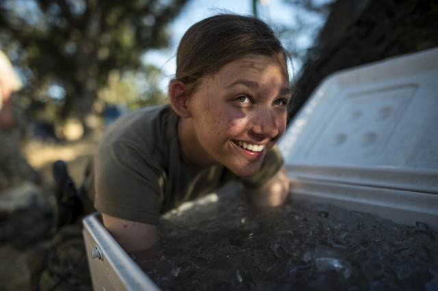 Pfc. Caitlin Salefski, of Decatur, Illinois, a U.S. Army Reserve military police gunner for the 339th Military Police Company (Combat Support), headquartered in Davenport, Iowa, dunks her arms in a cooler of ice in the heat of a Warrior Exercise (WAREX) held at Fort Hunter Liggett, California, June 19. The MP company's Soldiers had to relocate their tactical assembly areas in the field multiple times as they reconnoitered different areas of their operational environment, while fighting against temperatures reaching 100-plus degrees daily. (U.S. Army Reserve photo by Master Sgt. Michel Sauret)