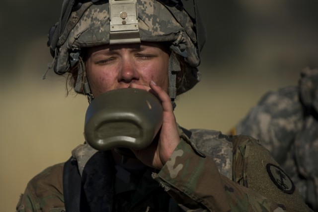 Pfc. Caitlin Salefski, of Decatur, Illinois, a U.S. Army Reserve military police gunner for the 339th Military Police Company (Combat Support), headquartered in Davenport, Iowa, drinks water in the heat of a Warrior Exercise (WAREX) held at Fort Hunter Liggett, California, June 19. The MP company's Soldiers had to relocate their tactical assembly areas in the field multiple times as they reconnoitered different areas of their operational environment, while fighting against temperatures reaching 100-plus degrees daily. (U.S. Army Reserve photo by Master Sgt. Michel Sauret)