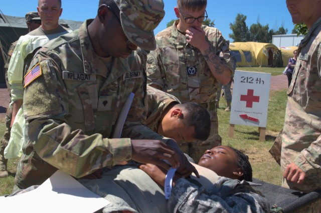 US Army Spc. Moses Kiplagat, a patient administration clerk with the 212th Combat Support Hospital, 30th Medical Brigade, applies a number band to a patient arriving to a mass casualty exercise at Mihail Kogalniceanu Air Base, Romania on July 16, 2017. The exercise was a part of Saber Guardian, a US European Command, US Army Europe-led exercise between the US and its Allies and partners that spans several countries in Eastern Europe, and is designed to foster readiness and strengthen relationships in the region. (Photo by Army Pfc. Nicholas Vidro, 7th Mobile Public Affairs Detachment)