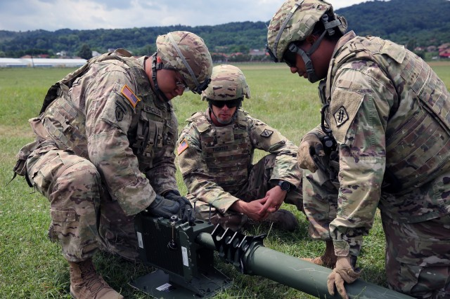 U.S. Army Soldiers assigned to Alpha Company, 44th Expeditionary Signal Battalion, 2nd Theater Signal Brigade, assemble a dedicated antenna to support the 648th Maneuver Enhancement Brigade, Georgia National Guard, forward command post for a river crossing July 16, 2017, near Ramnicu Valcea, Romania, during exercise Saber Guardian 17, a U.S. Army Europe-led, multinational exercise, taking place in Bulgaria, Hungary and Romania July 11-20, 2017.