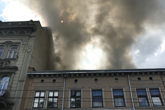 An apartment building on fire in Lviv, Ukraine on July 16. Soldiers with the Oklahoma Army National Guard's 45th Infantry Brigade Combat Team, deployed to Ukraine in support of the Joint Multinational Training Group-Ukraine, rushed into the burning building and evacuated the third floor before local firefighters arrived on scene.