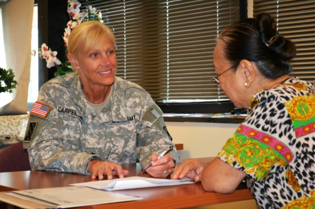 Lt. Col. Phyllis Carpenter, deputy 80th Training Command Staff Judge Advocate, provides legal advice the spouse of a veteran at Hunter Holmes McGuire VA Medical Center, Richmond, Virginia. Legal assistance services can be one of the most valuable benefits available to Soldiers and their Families on post.