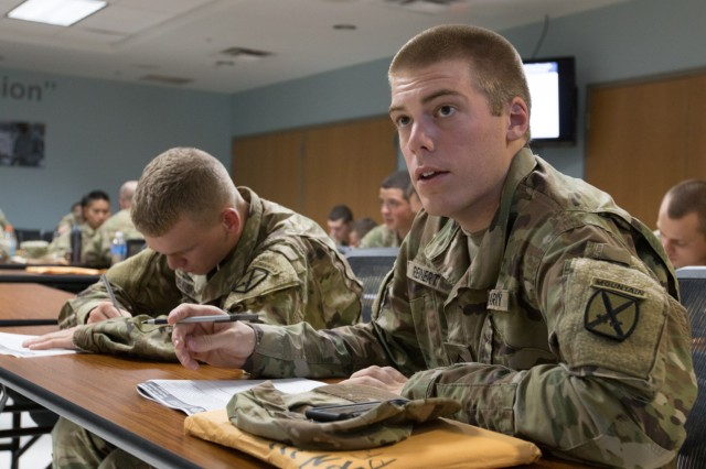 A new soldier attends a briefing on Comprehensive Soldier and Family Fitness in Clark Hall at Fort Drum, N.Y. The soldier completes a worksheet designed to help soldiers learn to deal with common stressors. The briefing helps soldiers develop resilience and teaches them positive coping skills.