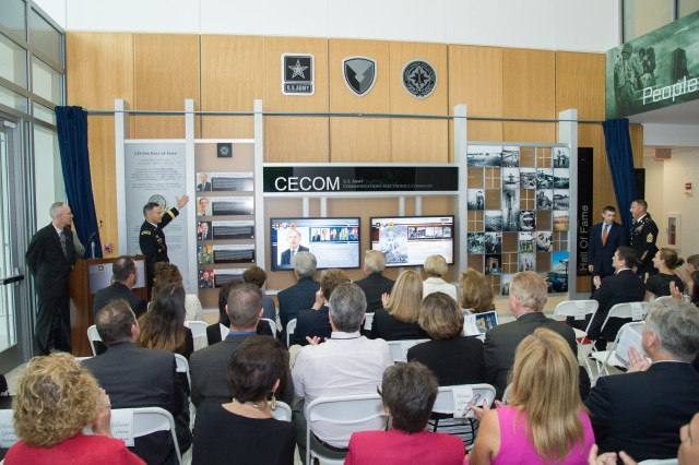 After the formal ceremony, the attendees gathered in the lobby of CECOM headquarters for the unveiling of an exhibit honoring the 2017 inductees.