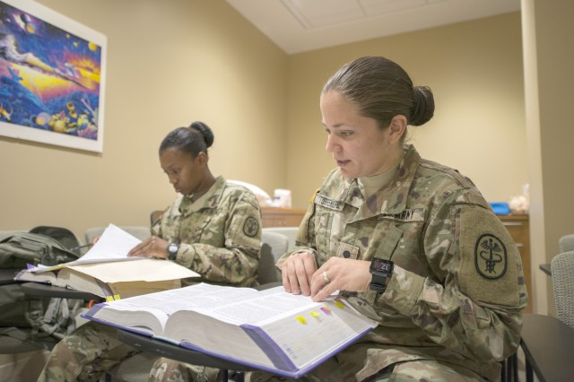 Pvt. 2 Naudia Glass, left, and Spc. Ashley Torrens, both currently in a yearlong program to become licensed practical nurses, take a study break during their clinical training at the Armed Forces Retirement Home in Washington, D.C., July 17, 2017. The pair of Soldiers and other promising Army nurses train at the home to hone their skills in geriatric care.