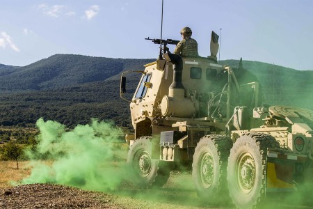 A Soldier from 277th Aviation Support Battalion engages a target during a convoy live fire exercise at Novo Selo Training Area, Bulgaria, on July 7. Soldiers engaged targets while on the move and ended with calling in a medevac helicopter during exercise Saber Guardian 17.