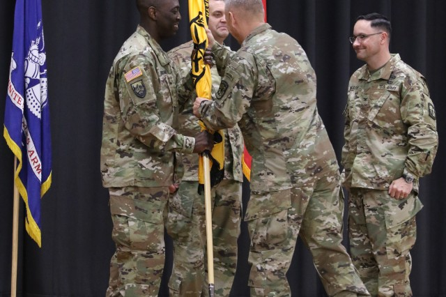 Maj. Gen. Christopher Hughes (center), commander of U.S. Army Cadet Command and Fort Knox, passes the 4th Brigade colors to incoming commander, Col. Farrell Duncombe (left), as outgoing commander, Col. Matthew Ingram (right), looks on during a change of command ceremony July 11 at Olive Theater.