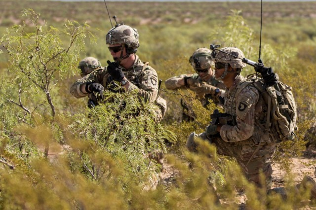 Soldiers with 1st Battalion, 26th Infantry Regiment, 2nd Brigade Combat Team, 101st Airborne Division, from Fort Campbell, Kentucky, call on the radio while conducting a live fire exercise during Network Integration Evaluation 17.2, July 14, Dona Ana Range Complex, New Mexico. 2nd BCT, 101st ABN DIV is the first rotational unit to participate in NIE. (U.S. Army photo by: Sgt. Maricris C. McLane)