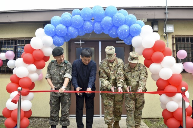 (From left to right) Lt. Col. Jung, Hyun-woong, Area IV ROK Army Support Group commander, Kim, Tae-hun, manager of Camp Walker KATUSA Snack Bar, Col. Robert P. Mann Jr., USAG Daegu commander, Command Sgt. Maj. Juan A. Abreu attend a ribbon cutting ceremony that marks the opening of the Camp Walker KATUSA Snack Bar, Jul. 10, 2017, Camp Walker, South Korea.