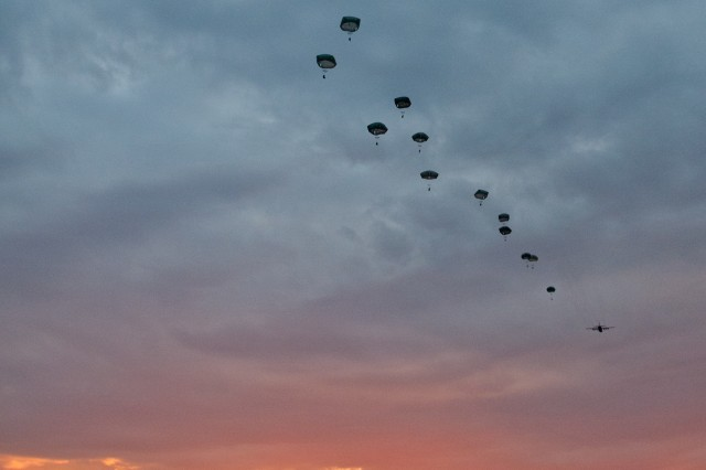 Soldiers with 1st Battalion, 503rd Infantry Regiment, 173rd Airborne Brigade, jump out of a U.S. Air Force Reserve C-130 Hercules aircraft during an airfield seizure training exercise at Bezmer Airbase, Bulgaria, on July 18 during exercise Swift Response.