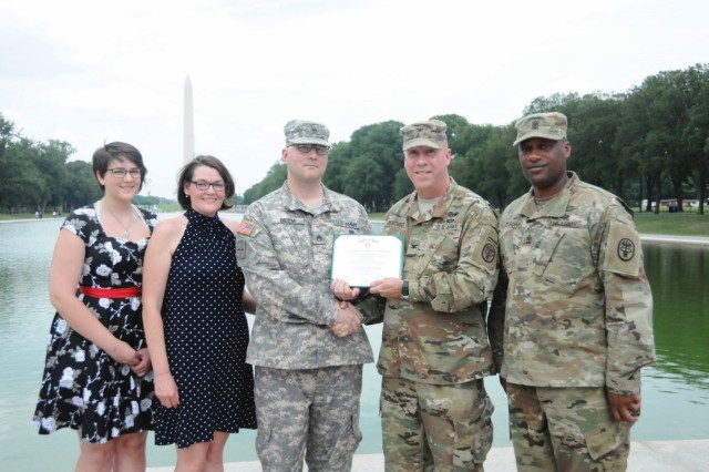 Col. David Oeschger (second from right) and Sgt. Maj. Lawrence Jordan (far right) honor Staff Sgt. Brian Beem (center) at his Purple Heart ceremony, July 13, 2017. Beem was joined by his wife Elizabeth (second from left) and daughter Kelly (far left). (Photo: Whitney Delbridge Nichels)