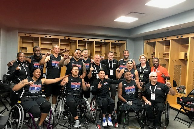 Army Team Physician Col. Travis Richardson (standing far right) poses with the wheelchair basketball team after its gold medal win at the 2017 Department of Defense Warrior Games. The DoD Warrior Games is an adaptive sports competition for wounded, ill and injured service members and veterans. Approximately 265 athletes representing teams from the Army, Marine Corps, Navy, Air Force, Special Operations Command, United Kingdom Armed Forces, and the Australian Defence Force will compete June 30 -- July 8 in archery, cycling, track, field, shooting, sitting volleyball, swimming, and wheelchair basketball.