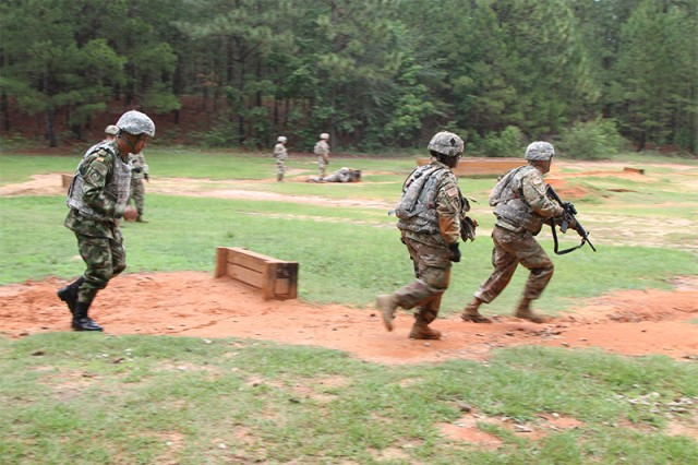 Colombian Sgt. Maj. Carlos Antonio Casio, (left), gives chase during a buddy team live fire movement drill May 24 at Ft. Jackson. The teams performing the exercise were drill sergeant cadets graduating from the academy on June 7.