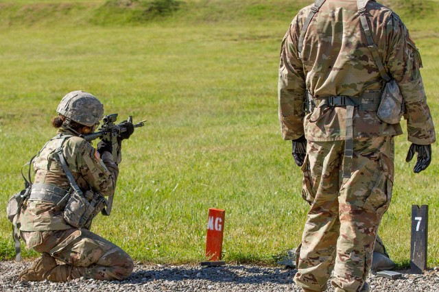Staff Sgt. Moses Mateo, assigned as a fire support specialist to 3rd Battalion, 6th Field Artillery, 1st Brigade Combat Team, observes as a U.S. Military Academy cadet at West Point fires her weapon on a known-distance target during summer training July 5.