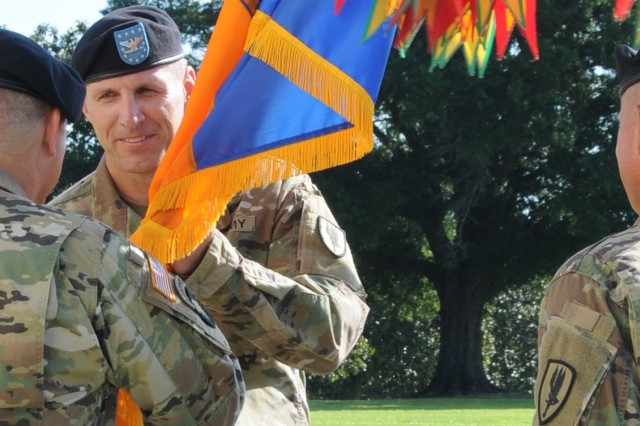 Col. Jason L. Miller, 1st Aviation Brigade commander, assumes command from Col. Woodard B. Hopkins as he accepts the unit colors from Maj. Gen. William K. Gayler, U.S. Army Aviation Center of Excellence and Fort Rucker commanding general, during a change of command ceremony on Howze Field July 14.