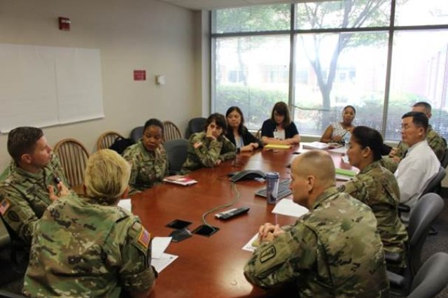 The Joint Commission team observed Brian Allgood Army Community Hospital's morning report, where leaders discussed the performance improvement program of becoming a high reliability organization, during their visit to the hospital June 28-29, 2017.