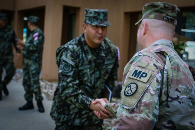 Maj. Thomas Poling (right), commander of task force security at the 2017 National Jamboree, greets Capt. Havier Matienzo of the Peruvian Army, during a State Partnership Program training opportunity at Summit Bechtel Reserve near Glen Jean, W.Va., July 18, 2017.