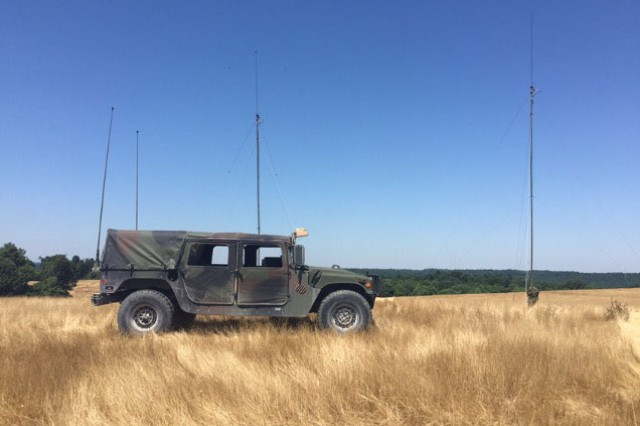 A Humvee from the 138th Field Artillery Brigade marks the first point of the longest recorded radio shot using standard issue equipment in Kentucky on Fort Knox June 9.